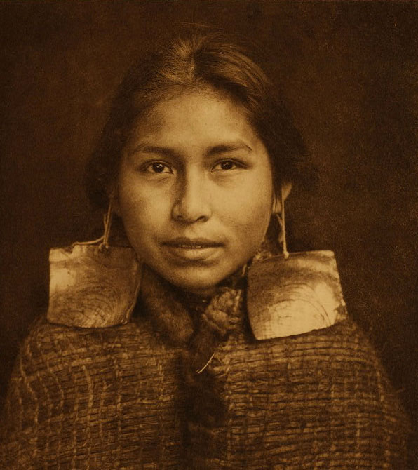 "TSAWATENOK GIRL, 1914, Edward Curtis ""The North American Indian"" THE KWAKIUTL TRIBE In its broadest application the term Kwakiutl is used to designate a large number of cognate tribes on the coast of British Columbia between the fiftieth and the fifty-forth parallels, the most northerly being the Haisla at the head of Douglas channel, and the most southerly the Lekwiltok at Cape Mudge and Campbell River ... The most valued ornaments of the wealthy class were ear-pendants and nose-rings of abalone shell ... it is related that about 1840 a Tsimshian man sailed to Oahu, Hawaii, aboard a trading ship on which he frequently had served as pilot. When he returned he bought several boxes of large abalone-shells, which he sold among the northern tribes, whence many of them were obtained by the Kwakiutl."